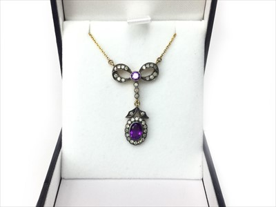 Lot 344-AN AMETHYST AND DIAMOND PENDANT
