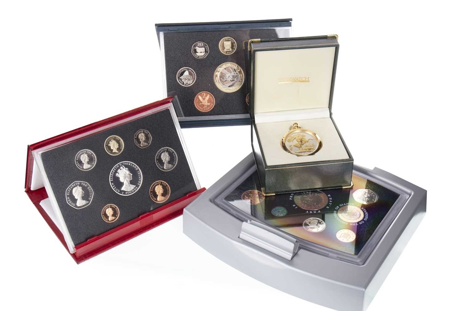 Lot 23-A LOT OF COIN SETS AND A COIN WATCH