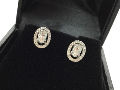 Lot 1320A-A PAIR OF DIAMOND EARRINGS