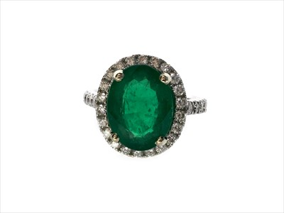 Lot 1310A-AN IMPRESSIVE EMERALD AND DIAMOND RING