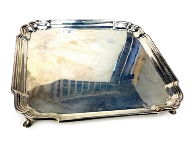 Lot 421-AN EARLY 20TH CENTURY SILVER SALVER
