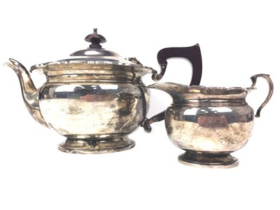 Lot 424-AN EARLY 20TH CENTURY SILVER TEAPOT AND CREAMER
