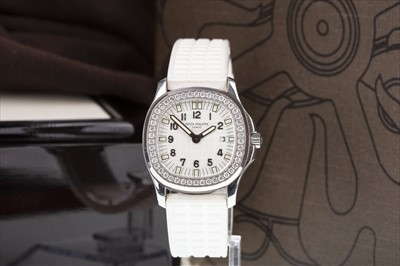 Lot 831-A LADY'S PATEK PHILIPPE AQUANAUT WRIST WATCH