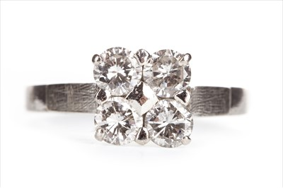 Lot 385 - A DIAMOND FOUR STONE RING