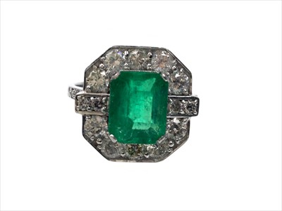 Lot 1338-AN EMERALD AND DIAMOND RING