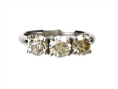 Lot 1353-A DIAMOND THREE STONE RING