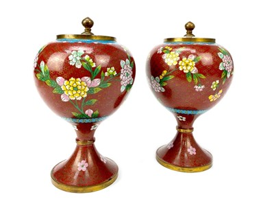 Lot 725-A PAIR OF 20TH CENTURY CHINESE CLOISONNÉ ENAMEL LIDDED POTS