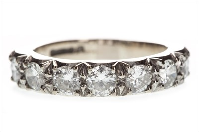Lot 812-A DIAMOND SEVEN STONE RING