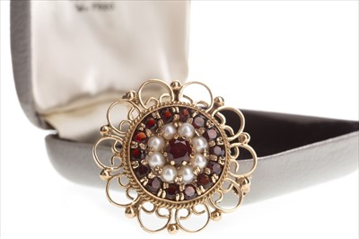 Lot 821-A RED GEM SET AND SEED PEARL BROOCH