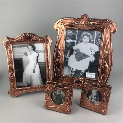 Lot 24-A LOT OF FOUR ART NOUVEAU STYLE PHOTOGRAPH FRAMES