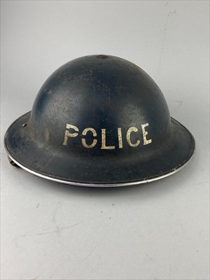 Lot 17-AN EARLY 20TH CENTURY POLICE HELMET