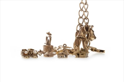 Lot 309-A GOLD CHARM BRACELET ALONG WITH LOOSE CHARMS