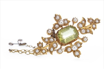 Lot 324-AN EDWARDIAN GEM AND SEED PEARL BROOCH