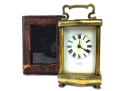 Lot 1128 - AN EARLY 20TH CENTURY BRASS CARRIAGE CLOCK