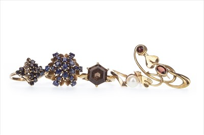 Lot 348-FOUR GEM SET RINGS AND A BROOCH