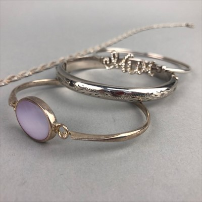 Lot 24-A LOT OF THREE BANGLES AND THREE NECKLACES