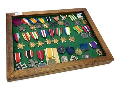 Lot 1620-A FRAMED GROUP OF BRITISH AND GERMAN WWI AND WWII MEDALS