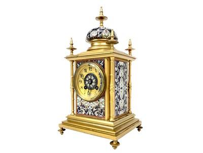 Lot 1132 - A VICTORIAN GILT METAL AND CHAMPLEVE ENAMEL MANTEL CLOCK