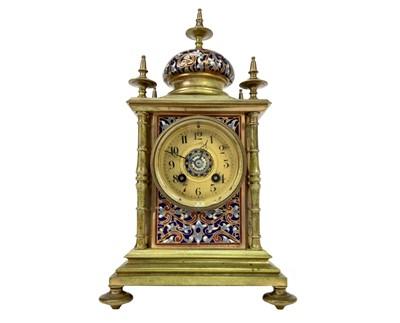 Lot 1136 - A VICTORIAN GILT METAL AND CHAMPLEVE ENAMEL MANTEL CLOCK