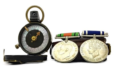 Lot 1141 - A WWI PRISMATIC COMPASS, POLICE LONG SERVICE MEDAL AND A DEFENCE MEDAL