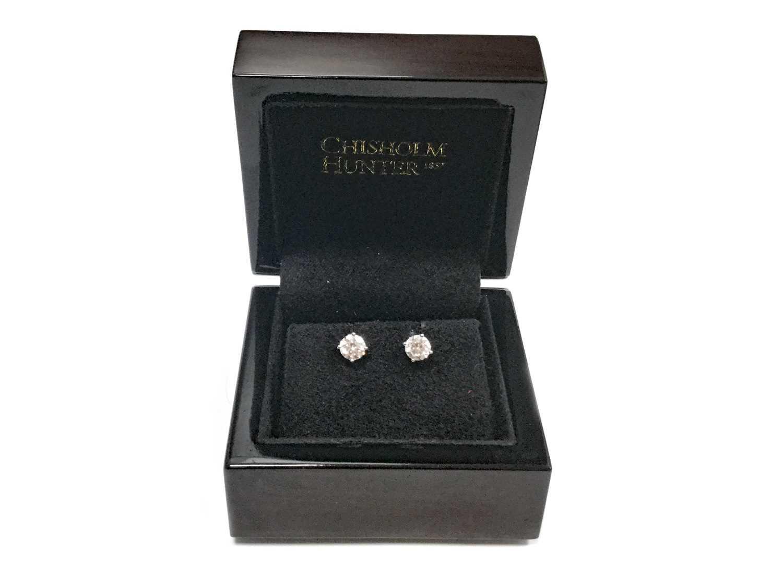 Lot 315-A PAIR OF DIAMOND STUD EARRINGS