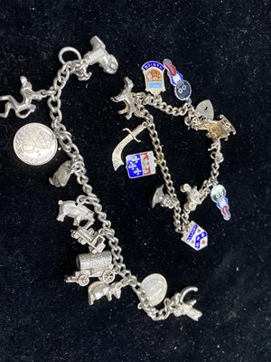 Lot 15-A LOT OF TWO SILVER CHARM BRACELETS