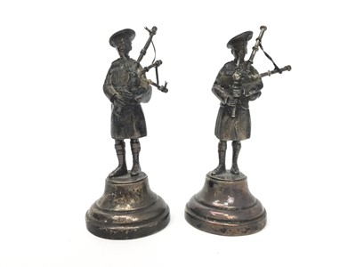 Lot 401-A PAIR OF SILVER FIGURES OF BAGPIPERS