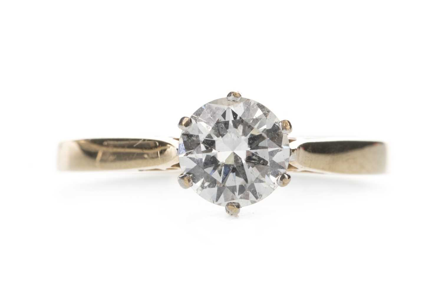 Lot 301-A DIAMOND SOLITAIRE RING