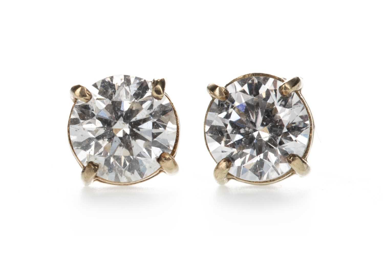 Lot 302-A PAIR OF DIAMOND STUD EARRINGS