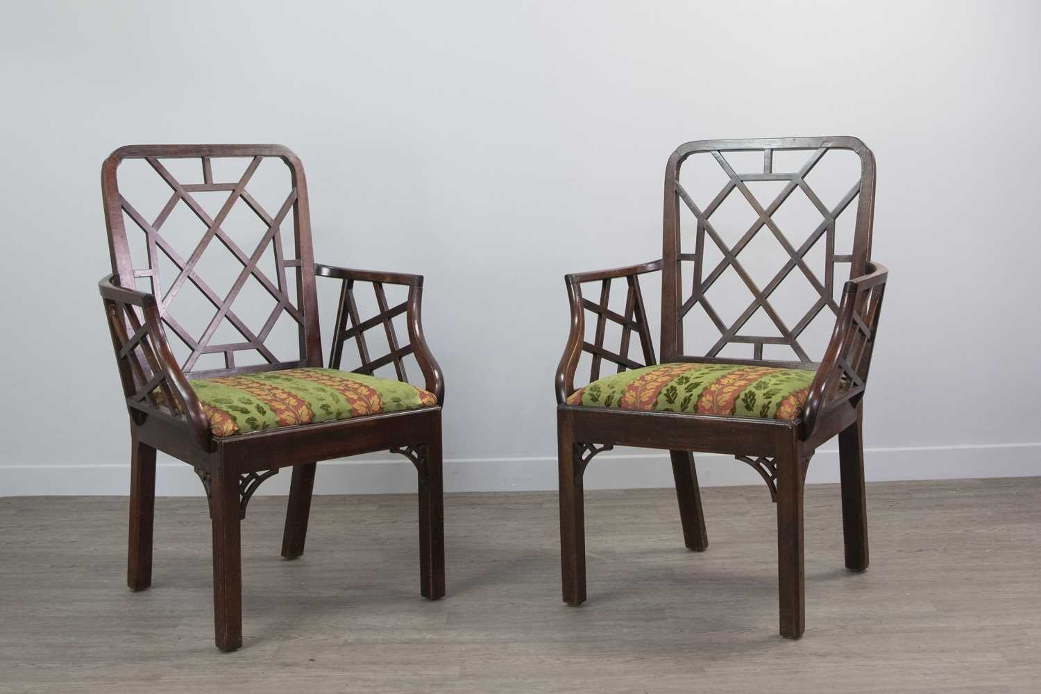 Lot 1215 - AN ATTRACTIVE NEAR PAIR OF GEORGE III CHINESE CHIPPENDALE MAHOGANY ELBOW CHAIRS