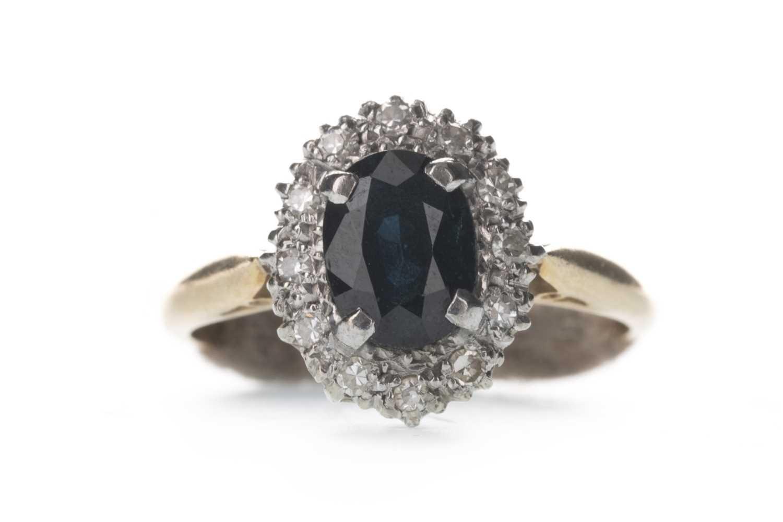 Lot 313-A BLUE GEM SET AND DIAMOND RING