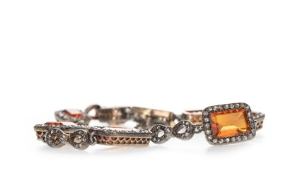 Lot 322 - AN ORANGE GEM SET AND DIAMOND BRACELET