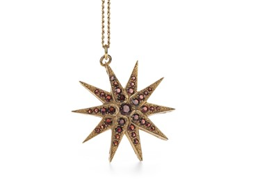 Lot 323 - A RED GEM SET STAR PENDANT
