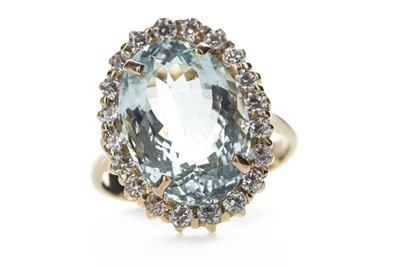Lot 387 - AN AQUAMARINE AND CUBIC ZIRCONIA RING