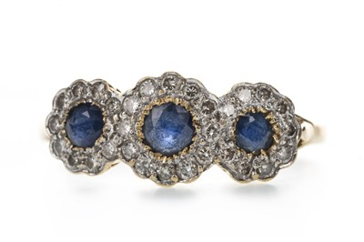 Lot 399 - A BLUE GEM SET AND DIAMOND RING