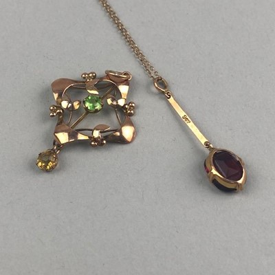 Lot 26-AN EDWARDIAN NINE CARAT  GOLD AND GEM SET PENDANT AND ANOTHER