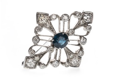 Lot 410 - A BLUE GEM SET AND DIAMOND BROOCH