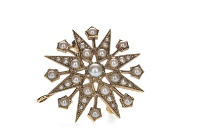 Lot 411 - A PEARL STAR BROOCH
