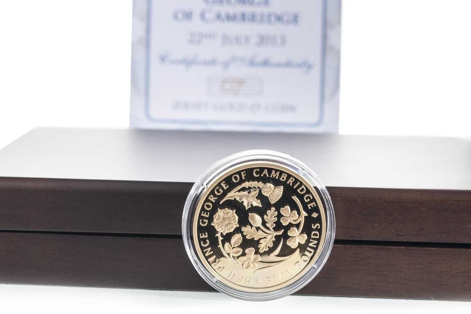 Lot 17-AN HRH PRINCE GEORGE JERSEY GOLD £5 COIN DATED 2013