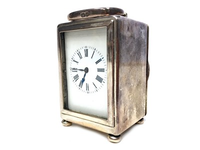Lot 1106-AN EARLY 20TH CENTURY SILVER CASED MINIATURE CARRIAGE CLOCK