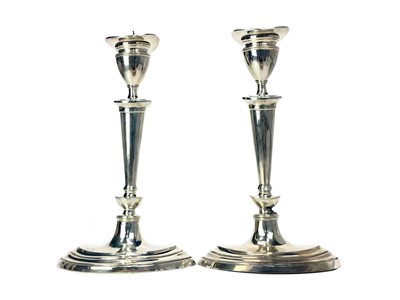 Lot 404-A PAIR OF EDWARDIAN SILVER CANDLESTICKS