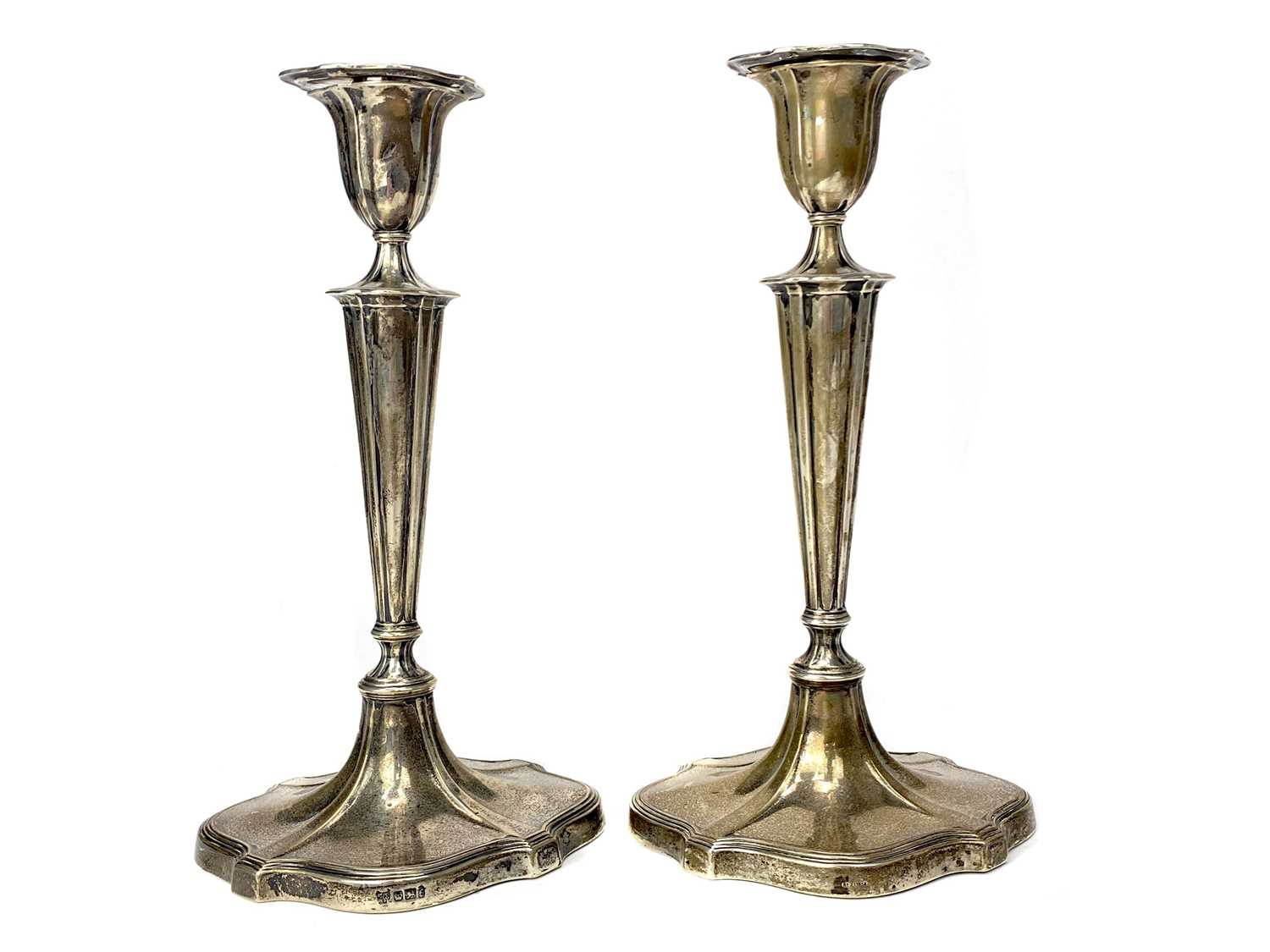 Lot 403 - A SET OF FOUR TABLE CANDLESTICKS OF NEOCLASSICAL DESIGN
