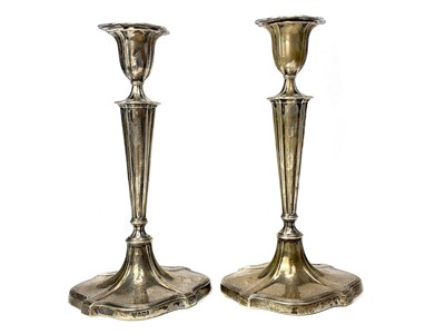 Lot 403-A SET OF FOUR TABLE CANDLESTICKS OF NEOCLASSICAL DESIGN