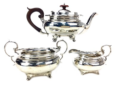 Lot 1306-AN EARLY 20TH CENTURY SILVER THREE PIECE TEA SERVICE