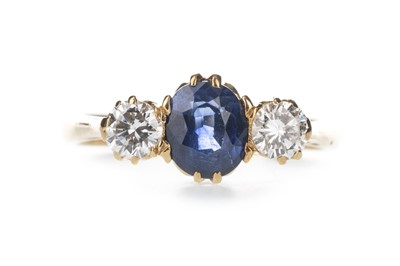 Lot 427 - A BLUE GEM SET AND DIAMOND RING