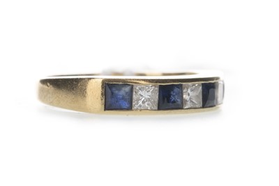 Lot 428 - A BLUE GEM SET AND DIAMOND RING