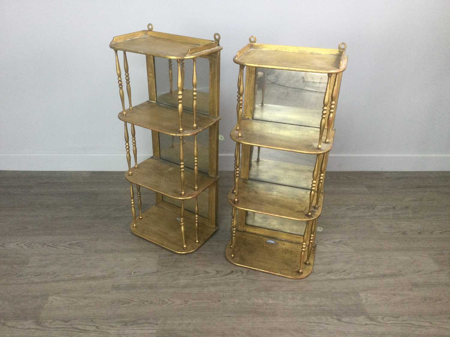 Lot 1269 - A PAIR OF VICTORIAN GILT PAINTED HANGING WALL SHELVES