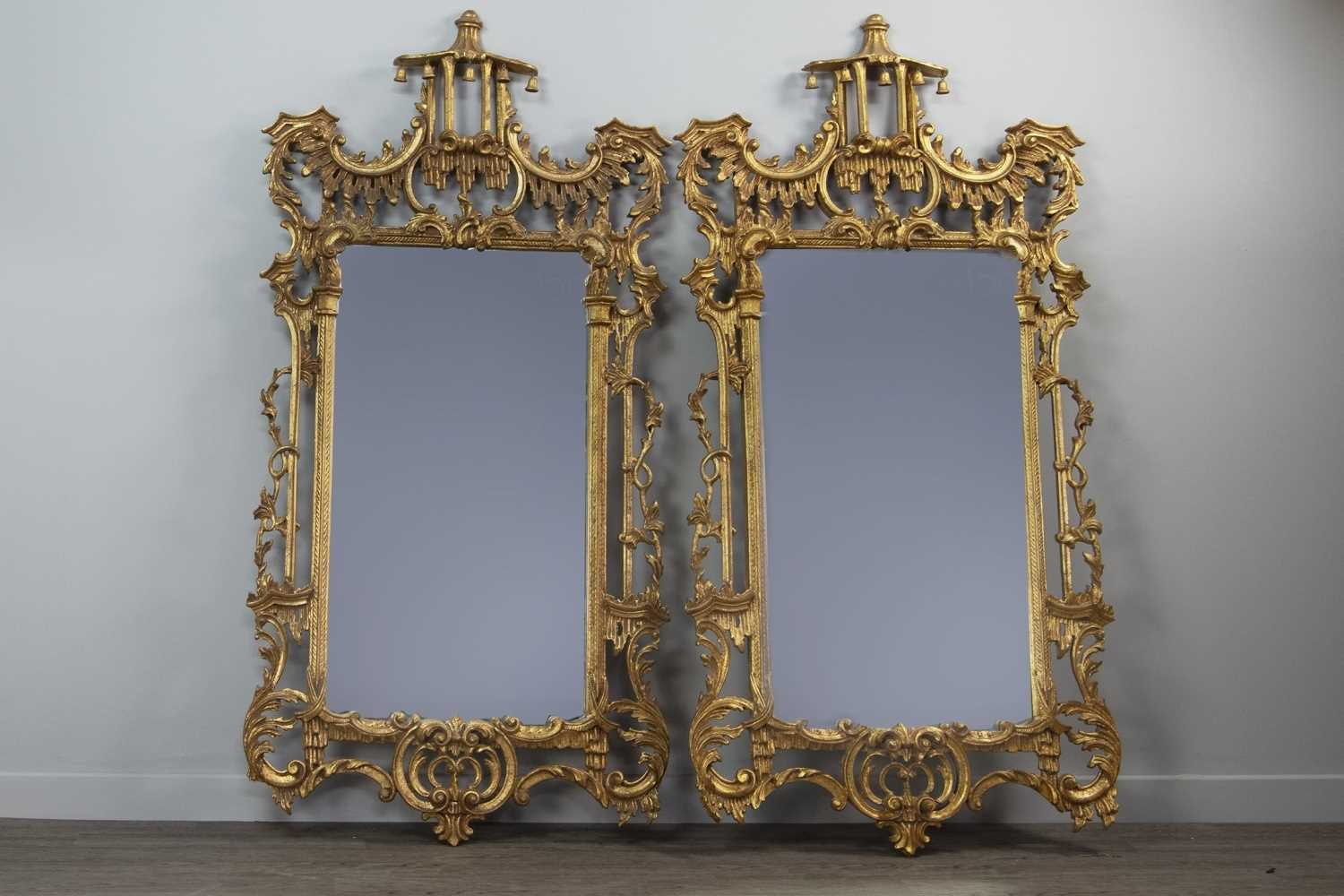 Lot 1349 - A PAIR OF GILT UPRIGHT WALL MIRRORS OF CHIPPENDALE DESIGN