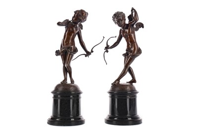 Lot 1433 - A PAIR OF LATE 19TH CENTURY BRONZE FIGURES OF CUPID WITH A BOW