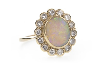 Lot 826 - AN OPAL AND DIAMOND RING